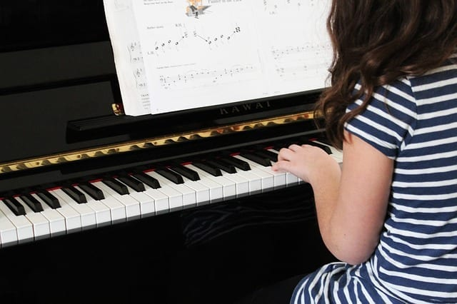 The best age to begin playing piano