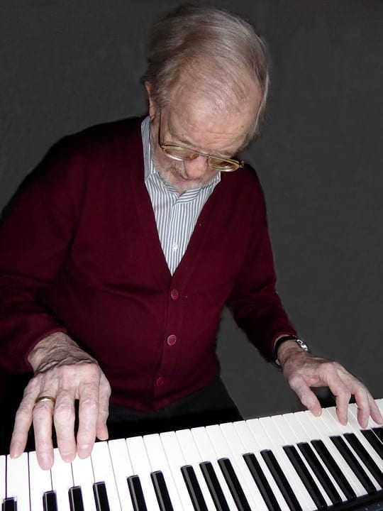 How should an adult beginner start learning piano?